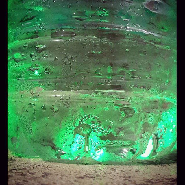 water bottle drops cold laser green light texture closeup ...