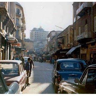 Beginning of Souk El Nouriyyeh behind cinema Opera that became the Virgin Megastore Building Beirut 1975 .