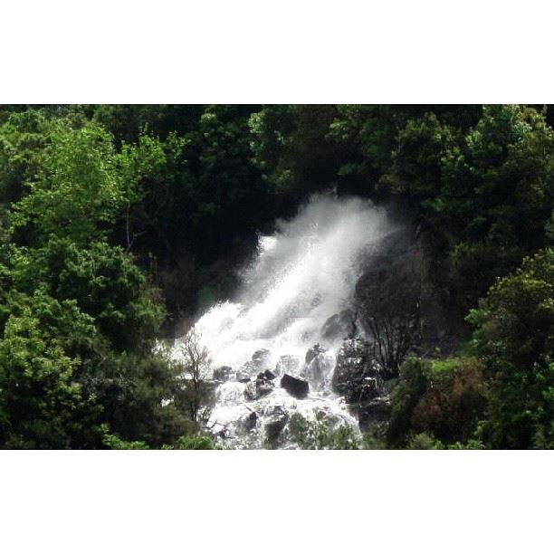 Source of waterfall in the heart of the rocky hills waterfall hill ...