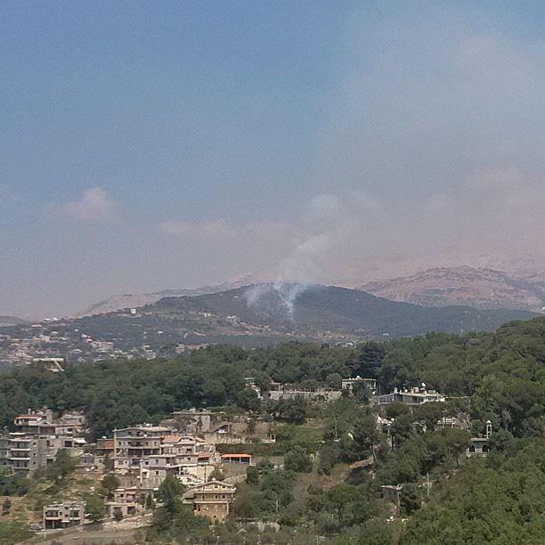 poor forest burning on fire somewhere near baskinta and kfaraakab ...