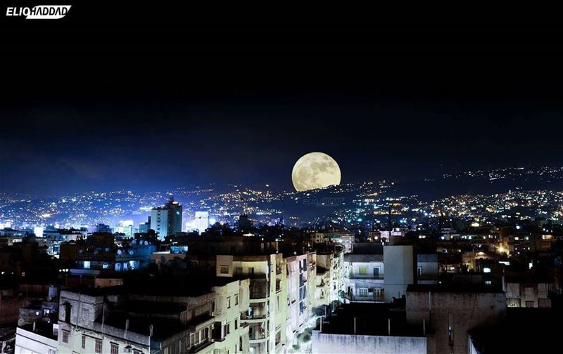 The supermoon picture taken from beirut city ! sky blue buildings...