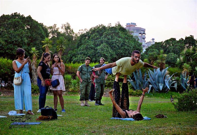 Two Lebanese practice acrobatics in the main park in Beirut, Lebanon,...