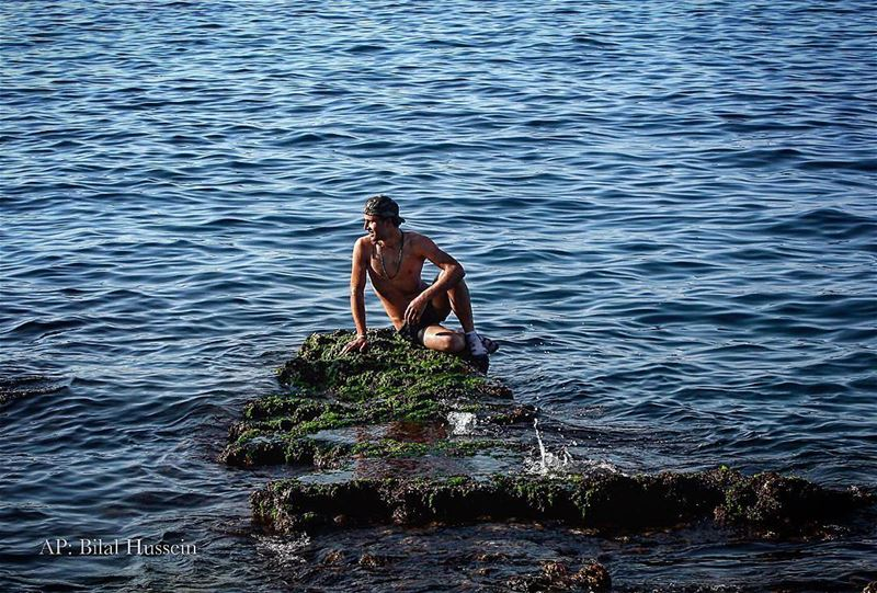 A Syrian man takes advantage of an unseasonably warm January afternoon, at...