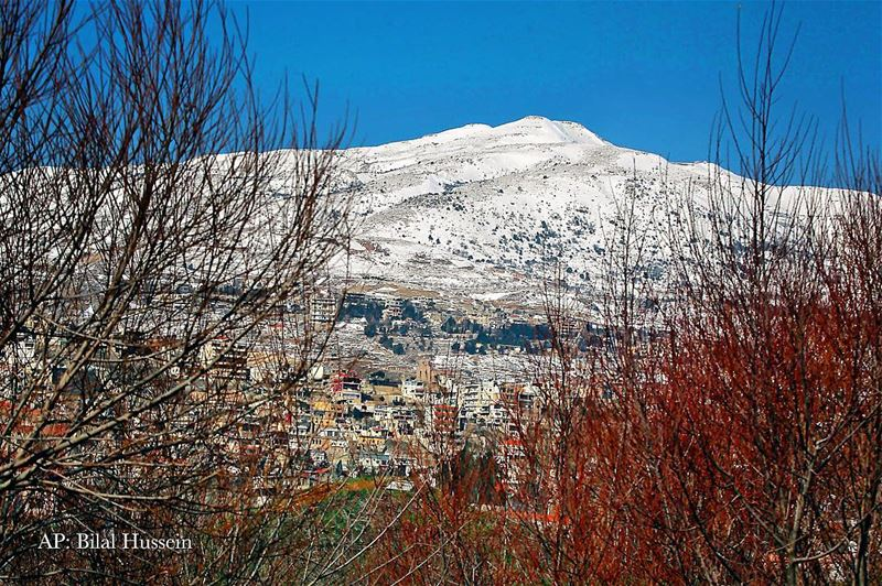 A general view shows mountains covered with snow in Dahr al-Baydar, Mount...