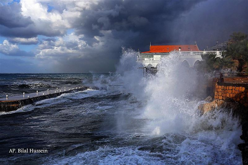 Huge waves crash on the sea defense wall of a restaurant, at the Beirut...