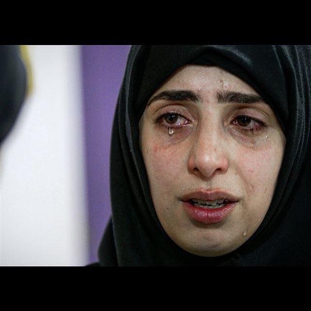 Hawraa Taleb weeps near her maternal cousin Haidar Mustafa, a three-year-ol