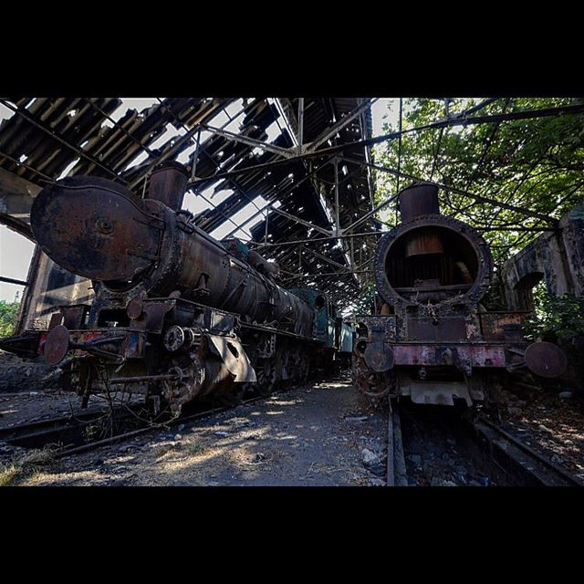 Rusted locomotives are seen at the defunct train station, in the northern...