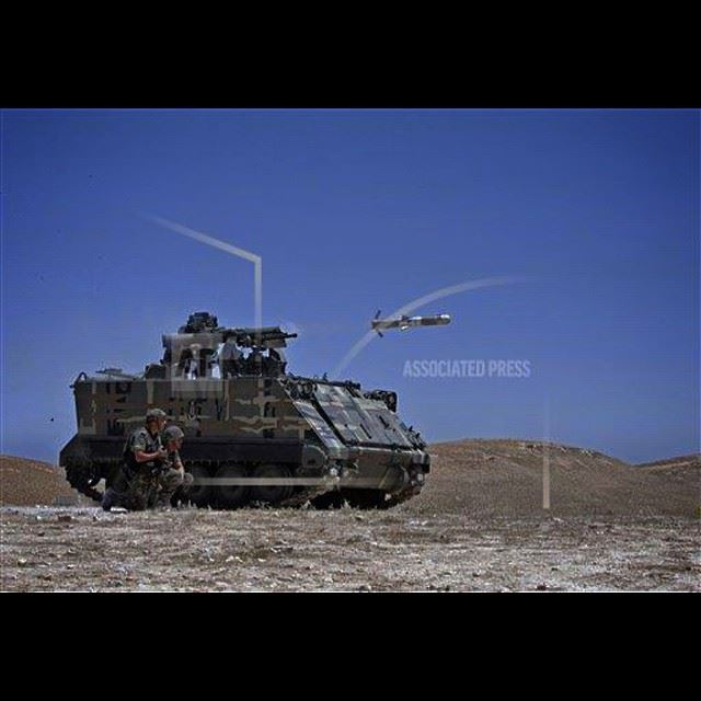 A Lebanese army vehicle fires a TOW-II missile in the village of Taybeh,...
