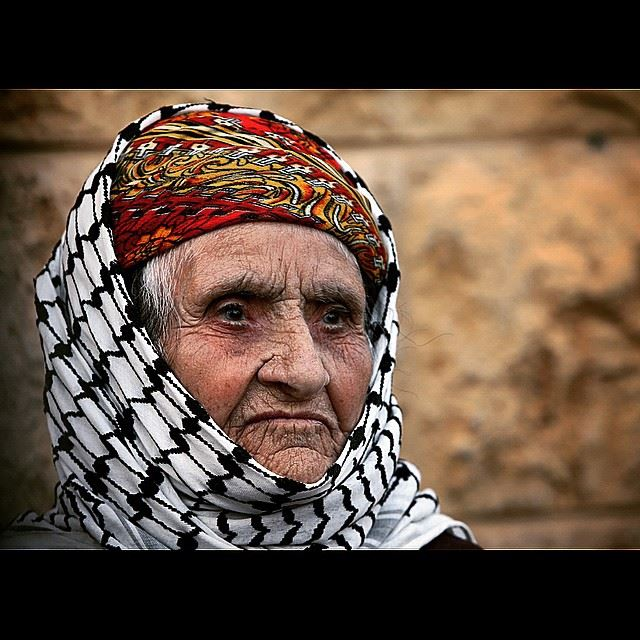 An Iraqi Chaldean Christian woman, who fled her home from Iraq, waits for...