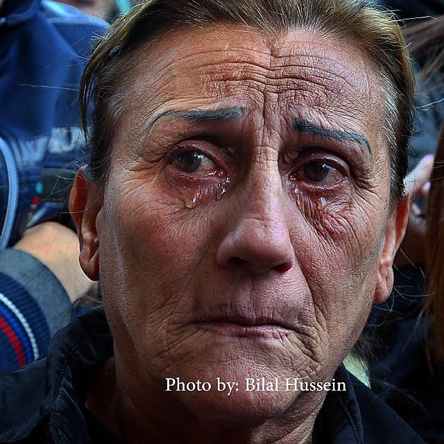 A Lebanese woman weeps as she look towards the coffin of Mohammed Chatah,...