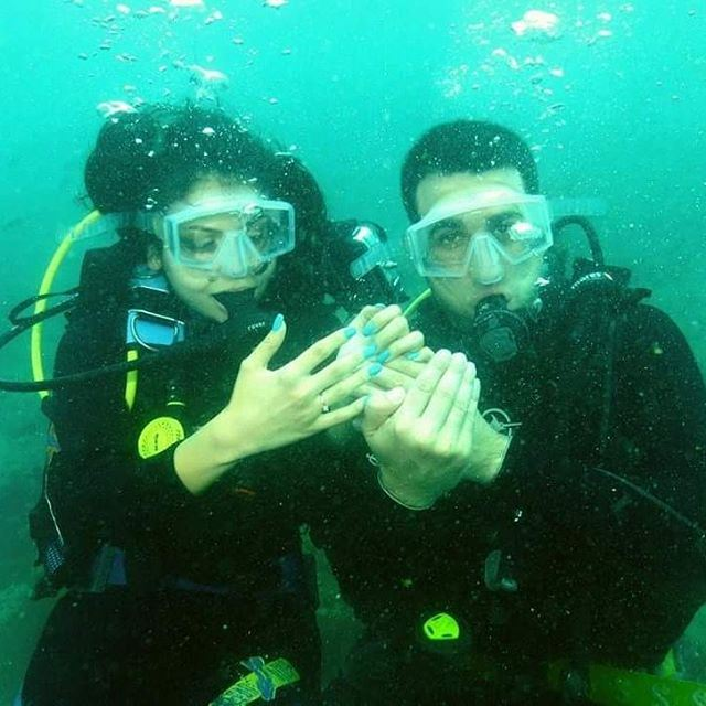 And she said YES in the coolest way ❤❤❤ diving romantic engagement love...