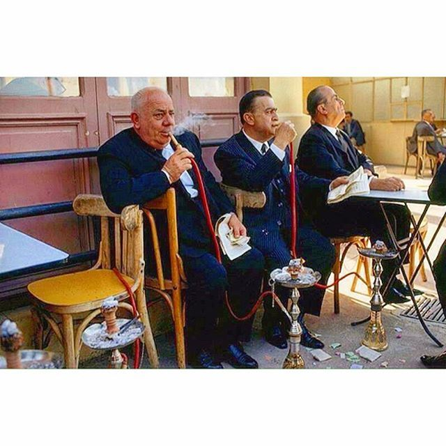 Beirut 1969 - Prosperous Men Smoking Nargileh at the horse race track and waiting for the results .