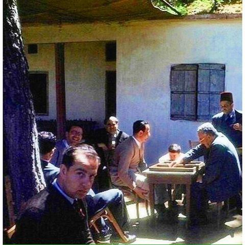 Hammana May 1948 , local residents and their visitor friends play a backgammon in the village coffee shop .