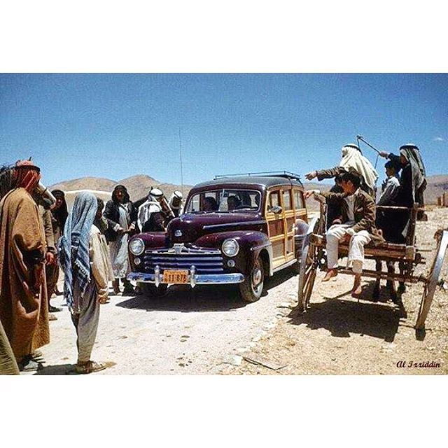 68 Years ago - Bekaa Valley on 24 May 1948 - the Photographer Ivan And his crew driving a woodie Car asks for directions to Baalbeck .