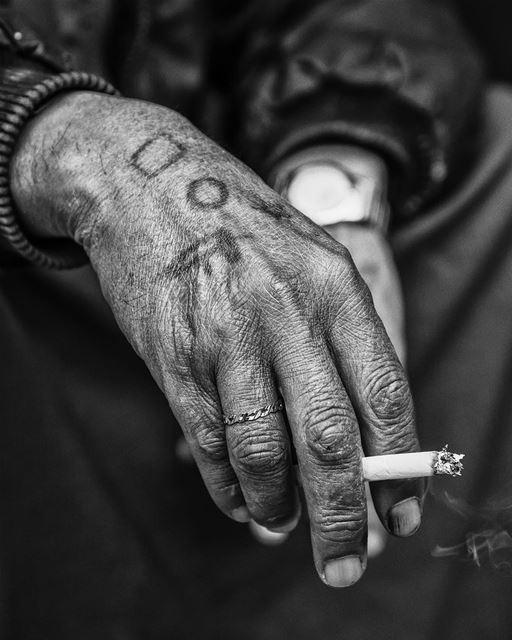 Burning time... shot taken in beirut hamrastreet smoking hands ...