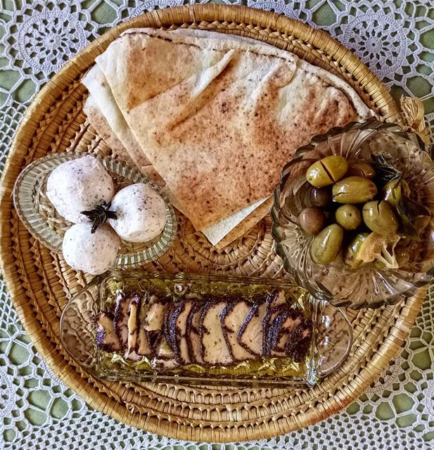 Homemade labneh shanklish and olives, the perfect breakfast. All that's...