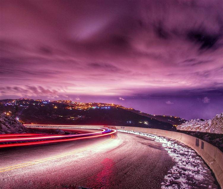 🌌🌌..... night nightphoto longexposure clouds mountains lights road... (Zaarour)