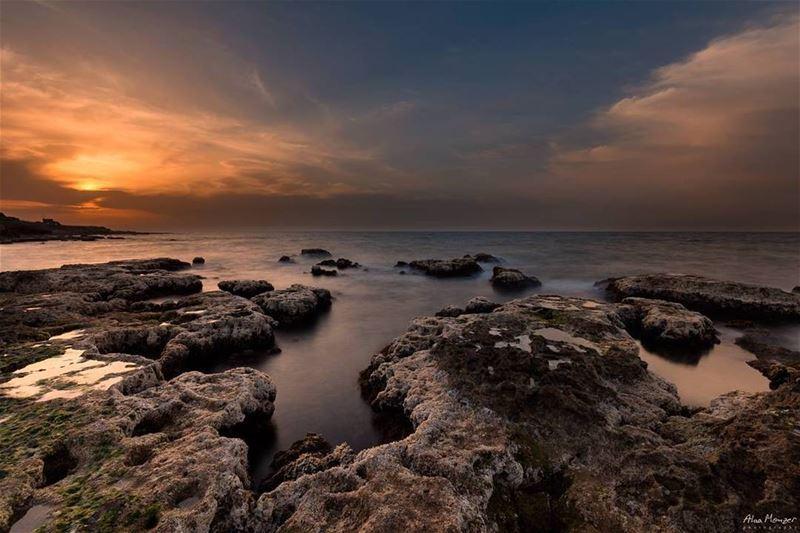 calm night beirut lebanon lebanese sunset rock clouds orange ...