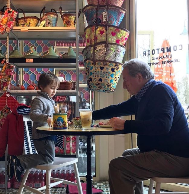 I just love this picture.. Grandad & grandson sharing mezze...... what I... (Comptoir Libanais)
