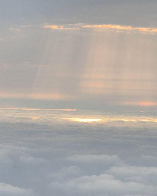 ... With clouds above and clouds below;The sunrays paint their own... (Arabian Gulf)