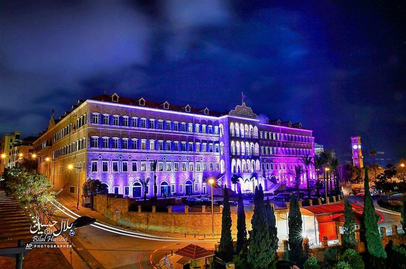 The government headquarters is illuminated in purple and fuchsia to mark...
