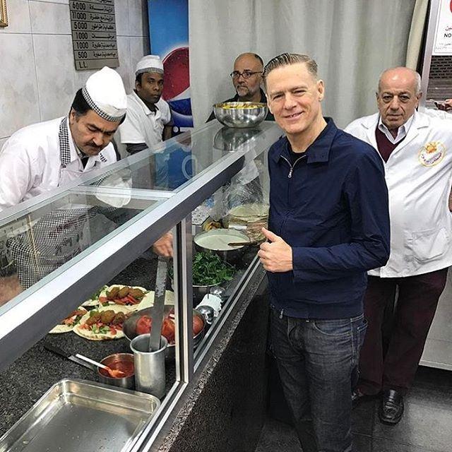 Bryan Adams enjoying Sahyoun's delicious falafel in Beirut before his...