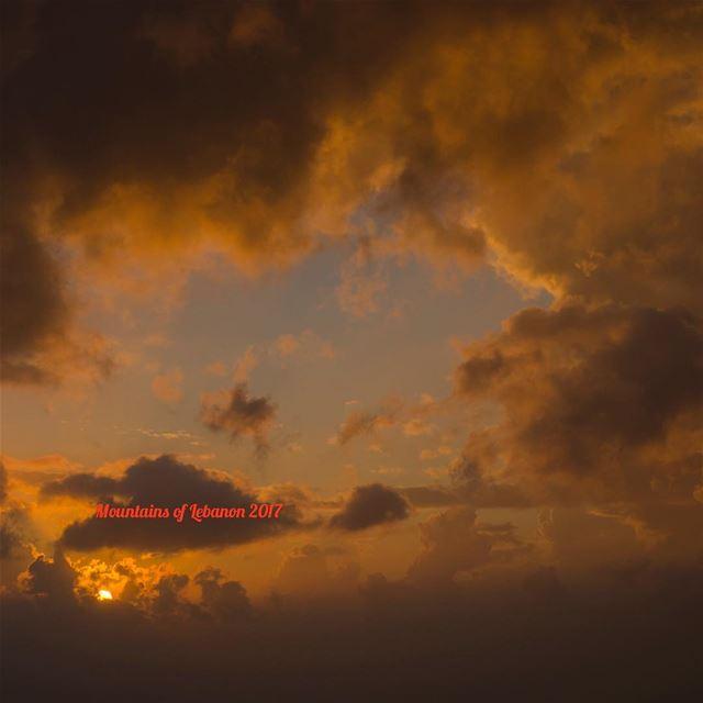 Just a regular sunset behind the stormy clouds... sunsets cloudedsunset... (Balloûné, Mont-Liban, Lebanon)