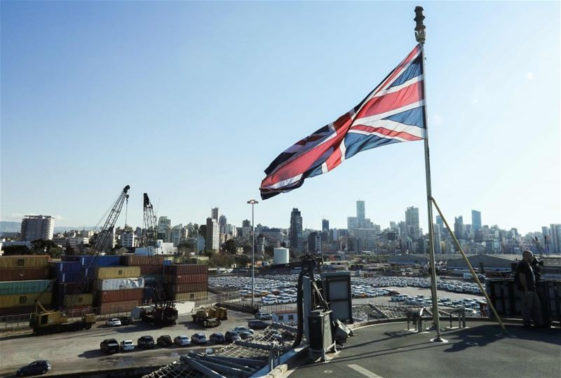 A British unionjack flag flying from the Royal Navy's HMS Ocean (L12) amphibious assault ship as it lies docked in the port of Beirut. (ANWAR AMRO / AFP) via pow.photos